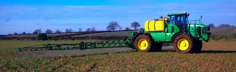 Farmer spraying field